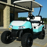 "EZGO 48 Volt Rxv Turquoise/White Golf Cart 6"" Lift"