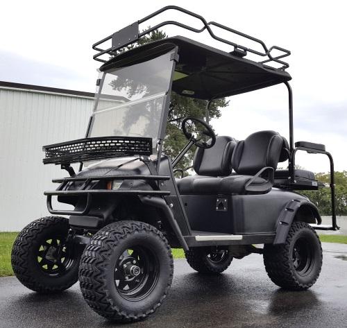 48v Electric EZ-GO TXT Black Hunter Edition Golf Cart on fox golf carts, carryall golf carts, used golf carts, easy go golf carts, custom golf carts, toro golf carts, gmc golf carts, sears golf carts, nissan golf carts, mitsubishi golf carts, electric golf carts, isuzu golf carts, arctic cat golf carts, 2015 golf carts, yamaha golf carts, john deere golf carts, cool golf carts, jacobsen golf carts, suzuki golf carts, club car golf carts,