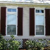 Stock Decorative Hinged Colonial Hurricane Shutters